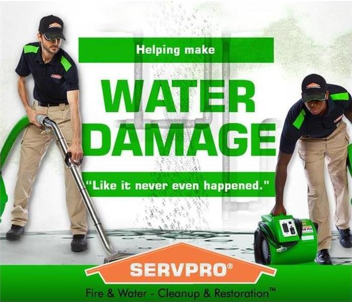 Two SERVPRO employees cleaning up water with water damage in green letters and a SERVPRO house logo on the bottom.