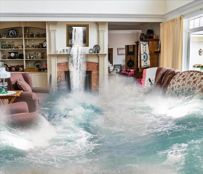 Flooded living room with red chairs and a floral couch under water and water flowing from a picture above a fireplace.
