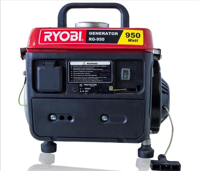 Portable red & black generator with a white background.